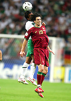 Tiago (19) of Portugal goes for a header in front of Pavel Pardo (8) of Mexico. Portugal defeated Mexico 2-1 in their FIFA World Cup Group D match at FIFA World Cup Stadium, Gelsenkirchen, Germany, June 21, 2006.