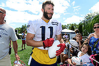 Wednesday, August 17, 2016: New England Patriots wide receiver Julian Edelman (11) signs a football for a fan at a joint training camp session between the Chicago Bears and the New England Patriots held at Gillette Stadium in Foxborough Massachusetts. Eric Canha/CSM