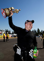 Aug. 4, 2013; Kent, WA, USA: NHRA top alcohol dragster driver Shawn Cowie celebrates after winning the Northwest Nationals at Pacific Raceways. Mandatory Credit: Mark J. Rebilas-USA TODAY Sports