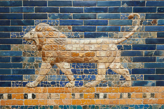 Coloured glazed brick panels depicting Lions stiding from the facade of the Throne Room dating from 604-562 BC. Babylon (present day Iraq). The throne room is situated in the third courtyard of the complex of the royal palace. Its 56 meters wide facade was decorated with coloured glazed bricks. A tentative reconstruction shows the composition of the upper part of the facade, including the stylised palms and geometric patterned registers. Two original sections are displayed on the left next to the Ishtar Gate. The lower part f the facade with representations of the striding lions was predominantly reconstructed from the original baked brick fragments. The frieze of lions was presumably arranged symmetrically so the animals faced towards the central main entrance to the Throne room. The throne room was excavated by Robert Koldewey between 1899 and 1917. It was used as an official reception room. The Vorderasiatisches Museum, part of the Pergamon Museum, Berlin