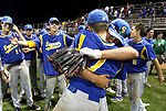 MIDDLETOWN CT. 09 June 2018-060918SV19- #12 David John Kirpas and #1 Ethan Szerszen of Seymour hug as Seymour High players celebrate after beating Wolcott High 13-2 in the CIAC Class M baseball championship in Middletown Saturday. <br /> Steven Valenti Republican-American