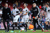 Pictured: Chico Flores of Swansea (C) walking off the pitch with team mates Wilfried Bony (2nd L) David Cornell (4th L) and Ben Davies (R). 01 February 2014<br /> Re: Barclay's Premier League, West Ham United v Swansea City FC at Boleyn Ground, London.