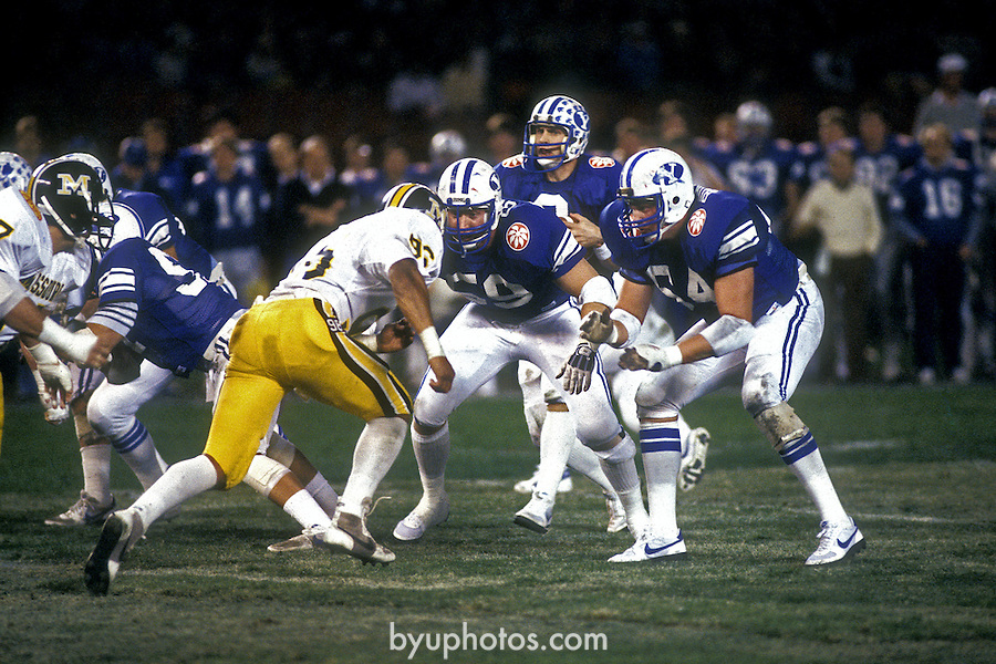 83 Holiday-Young.tif<br /> <br /> Football Holiday Bowl. 8 Steve Young. 64 Rex Burningham. 59 Craig Garrick.<br /> <br /> Dec 23, 1983<br /> <br /> Box Number: 6371<br /> <br /> Photo by: Mark Philbrick/BYU<br /> <br /> Copyright BYU PHOTO 2008<br /> All Rights Reserved<br /> 801-422-7322<br /> photo@byu.edu