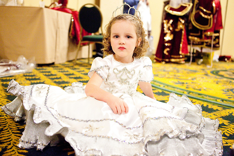 A page to the Queen, at the Krewe of Carrollton's ball in New Orleans on February 5, 2010.