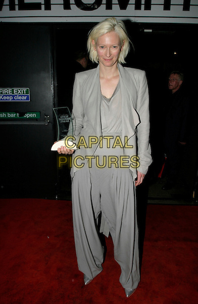TILDA SWINTON.The British Independent Film Awards at Hammersmith Palais, London, UK..November 30th, 2005.Ref: AH.full length grey gray trousers flowing loose jacket award trophy.www.capitalpictures.com.sales@capitalpictures.com.©Capital Pictures