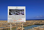 Sign notice at historic ancient salt pans on coast near Marsalforn, island of Gozo, Malta