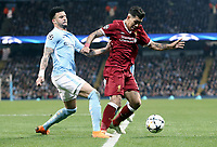 Liverpool's Roberto Firmino shields the ball from  Manchester City's Kyle Walker<br /> <br /> Photographer Rich Linley/CameraSport<br /> <br /> UEFA Champions League Quarter-Final Second Leg - Manchester City v Liverpool - Tuesday 10th April 2018 - The Etihad - Manchester<br />  <br /> World Copyright &copy; 2017 CameraSport. All rights reserved. 43 Linden Ave. Countesthorpe. Leicester. England. LE8 5PG - Tel: +44 (0) 116 277 4147 - admin@camerasport.com - www.camerasport.com