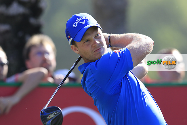 Danny Willett (ENG) tees off the 11th tee during Sunday's Final Round of the 2016 Omega Dubai Desert Classic held at the Emirates Golf Club, Dubai. 7th February 2016.<br /> Picture: Eoin Clarke | Golffile<br /> <br /> <br /> All photos usage must carry mandatory copyright credit (&copy; Golffile | Eoin Clarke)