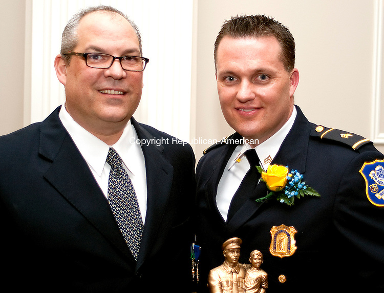 WATERBURY,  CT, 28 MARCH  2012-032812JS07-Waterbury Chief of Police Michael J. Gugliotti with Police Office of the Year, Sgt. Tim LaMontagne at the Exchange Club of Waterbury's Dr. Lawrence J. Shea Awards Banquet held at La Bella Vista in Waterbury. . Jim Shannon Republican-American
