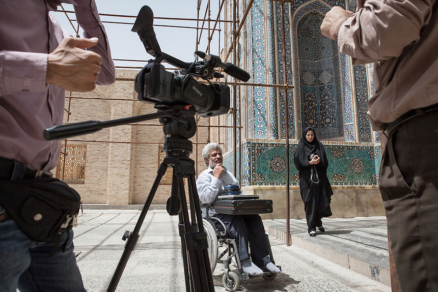 "Iranian film-maker shoots for footage of his movie about first Gulf War (Iran against Iraq) victims in front of Jameh Mosque of Yazd. Iranian movie industry is quite notable in the world for its complex and insightful story. Recently ""A Separation"" gained the prize as the best foreign language film at Oscars 2012."