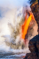 molten lava firehose, explosively pouring into the ocean, out of a lava tube, lava ocean entry at Kamokuna, Hawaii Volcanoes National Park, Big Island, Hawaii, USA, Pacific Ocean