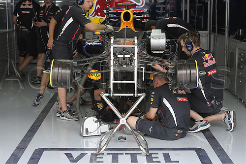 20.04.2012 A bunch of mechanics prepare the car of German Formula One driver Sebastian Vettel of Red Bull for the second practice session on the Bahrain International Circuit in Sakhir, near Manama, Bahrain.