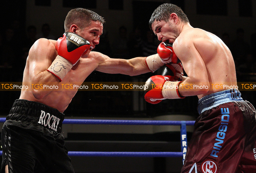 Matthew Marsh (claret/blue shorts) defeats Rocky Dean (Thetford, black shorts) in a Super-Bantamweight boxing contest for the British Title at York Hall, Bethnal Green promoted by Frank Warren / Sports Network - 21/11/08 - MANDATORY CREDIT: Gavin Ellis/TGSPHOTO - Self billing applies where appropriate - 0845 094 6026 - contact@tgsphoto.co.uk - NO UNPAID USE.