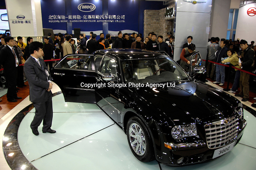 Visitors view locally produced Chrysler 300C at stand of Beijing Benz-DaimlerChrysler Automotive Corporation (BBDC) during the 2006 International Automotive Exhibition in Beijing..19 Nov 2006