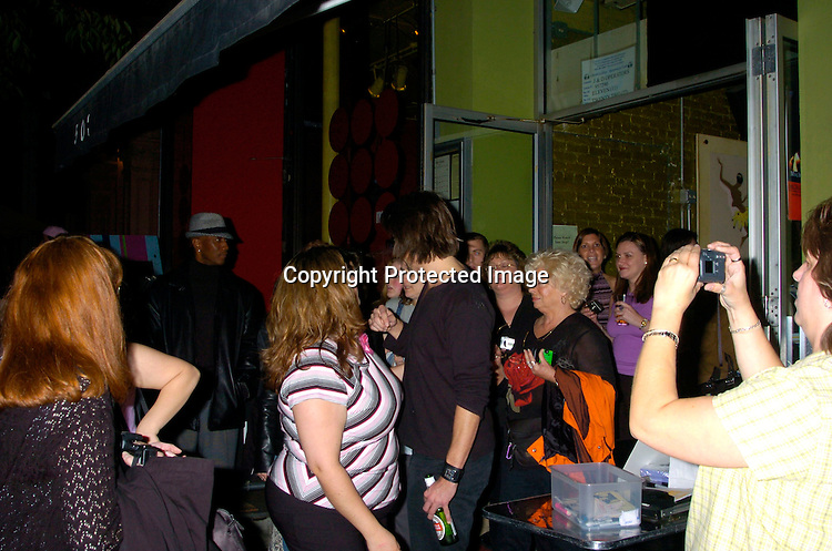Micheal Easton and fans..at Prohibition Night Club  for the Gabriel Project Benefit on June 5, 2004 in New York Citiy. The Gabriel Project provides heart surgery for children from developing countries.                                                                                Photo by Robin Platzer, Twin Images