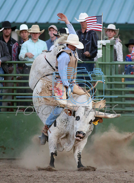 Sterling Ward competes in the bull riding event at the Smackdown Tour at Fuji Park in Carson City, Nev., on Saturday, June 7, 2014.<br /> Photo by Cathleen Allison