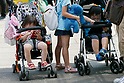 Children catch Pokemon characters on their smartphones on one of the hottest days of the summer at Pokemon GO PARK in Yokohama Minatomirai on August 9, 2017, Yokohama, Japan. Hundreds of Pokemon GO app fans gathered at the special Pokemon GO PARK, a 2km area including special PokeStops and PokemonGyms, to collect characters. Minatomirai holds an annual Pokemon event including a parade of 1500 Pikachu through the area and this year has added Pokemon GO attractions. Pokemon GO PARK is open from August 9 to 15. (Photo by Rodrigo Reyes Marin/AFLO)
