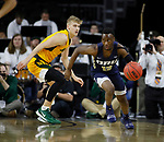 SIOUX FALLS, SD - MARCH 8: R.J. Fuqua #12 of the Oral Roberts Golden Eagles pushes the ball up court past Sam Griesel #5 of the North Dakota State Bison at the 2020 Summit League Basketball Championship in Sioux Falls, SD. (Photo by Richard Carlson/Inertia)