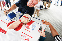 Chris Perka tries to hold off being pinned during an arm wrestling match at the Staten Island Borough Championship on June 18, 2005.