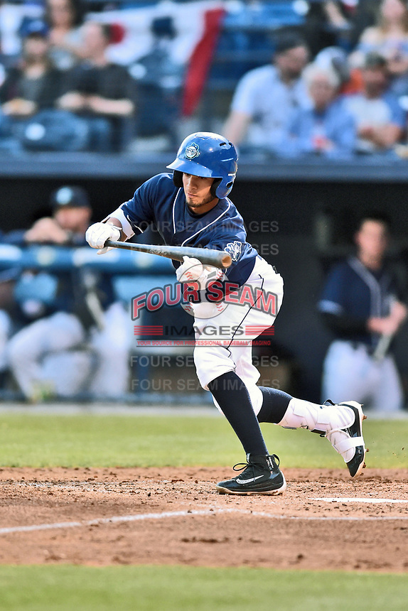 Asheville Tourists center fielder Manny Melendez (19) attempts to lay down bunt during a game against the Greenville Drive at McCormick Field on April 13, 2017 in Asheville, North Carolina. The Tourists defeated the Drive 3-1. (Tony Farlow/Four Seam Images)
