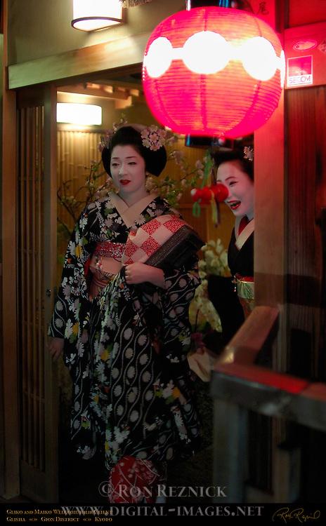 Geiko Geisha Maiko Apprentice Welcome Client to Ochaya Gion District Kyoto Japan