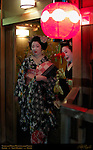Geiko Geisha Maiko Apprentice Welcome Client to Ochaya Gion District Kyoto Japan