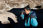 Team member Raj Kumar has a morning Chai (sweet milky tea) on the morning of day three of a  three day hike toward the fast reducing Rathong Glacier below the 6678 meter Rathong Peak  in the North East Indian state of Sikkim close to the Nepalese border led by  Dr Shresth Tayal ,Glaciologist at The Energy and Resources Institute (TERI). Considered to be a themometre of the environment, it has been chosen by TERI to be a test case of environmental damage being done in India and China. Dr. Tayal is conducting three dimensional tests that include measuring the depth of the ice to form concrete conclusions on the fate of the glacier.The Indian Government is denying the glaciers' demise despite data suggesting it has been reduced by more than over 80% in the last 42 years.