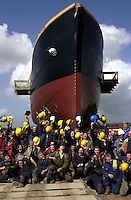 JEANIE JOHNSTON LAUNCHED 19-4-00.The Jeanie finally gets out...!.Hats off to a job well done as the workers on the Jeanie Johnston celebrate after sucessfully moving the ship onto a barge at Blennerville on Wednesday. Now time and tide are working against getting the 500 ton ship to Fenit for final fitting before the weekend as the last of the spring tides are due on Saturday..Picture by Don MacMonagle
