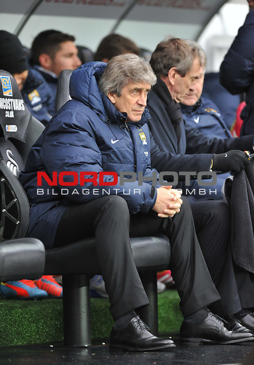 Manchester City Manager, Manuel Pellegrini -  01/01/2014 - SPORT - FOOTBALL - Liberty Stadium - Swansea - Swansea City v Manchester City - Barclays Premier League<br /> Foto nph / Meredith<br /> <br /> ***** OUT OF UK *****