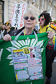 "15 March 2014, London, UK. Protest to remember the Fukushima Daiichi nuclear disaster. Japanese and British protesters called for an end to nuclear power on the 3rd anniversary of the nuclear disaster in Japan outside the gates to Downing Street, London. The protest was supported by ""Japanese Against Nuclear"" and the Campaign for Nuclear Disarmament, CND."