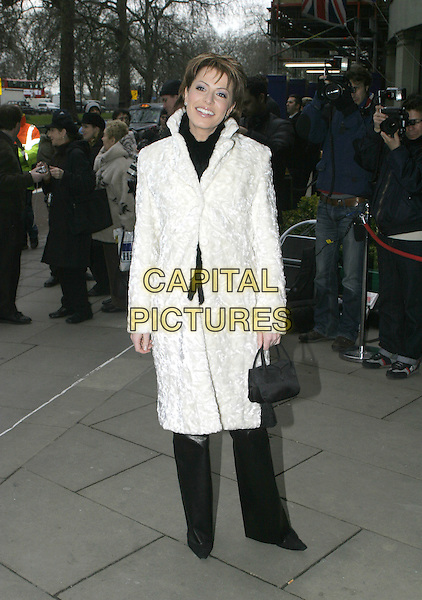 NATASHA KAPLINSKY - KAPLINSKI.TRIC Awards - Television & Radio Industries Club at the Grosvenor House, Park Lane..March 8th, 2005.full length white fur coat black purse.www.capitalpictures.com.sales@capitalpictures.com.© Capital Pictures.