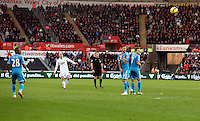 SWANSEA, WALES - FEBRUARY 07: Jonjo Shelvey of Swansea (2nd L) takes a free kick during the Premier League match between Swansea City and Sunderland AFC at Liberty Stadium on February 7, 2015 in Swansea, Wales.