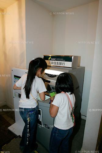 """KIDZANIA TOKYO, """"Edutainment City"""",.children withdrawing Kudzos from the SMBC ATM."""