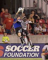 Real Salt Lake goalkeeper Nick Rimando (18) intercepts high pass to Toronto FC defender Nana Attakora (3). Salt Lake Real defeated Toronto FC, 3-0, at Rio Tinto Stadium on June 27, 2009.