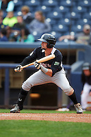 New Britain Rock Cats designated hitter David Dahl (1) squares to bunt during a game against the Akron RubberDucks on May 21, 2015 at Canal Park in Akron, Ohio.  Akron defeated New Britain 4-2.  (Mike Janes/Four Seam Images)