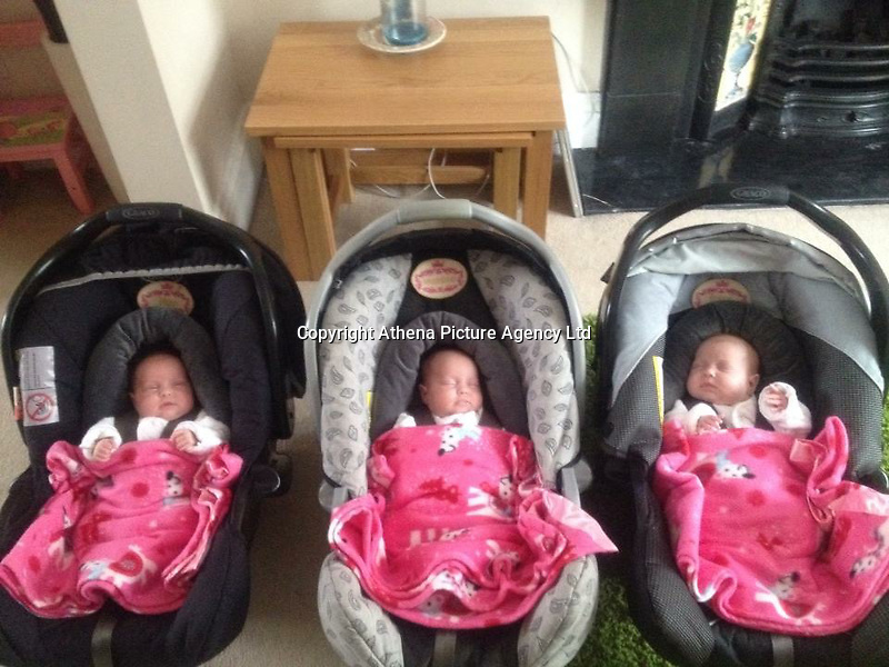 Pictured: The three sisters when they went home from hospital<br /> Re: A set of identical triplets have been colour-coded to help teachers tell them apart on their first day in nursery school.<br /> Three-year-olds Ffion, Maddison and Paige Gilbert, are so alike even their parents struggle to know which is which.<br /> Karen and Ian Gilbert used different coloured nail-varnish on their fingers and toes to identify them when they were babies.<br /> Now the couple are using the same colours for their hair bands and bobbles at the nursery where they have just enrolled.<br /> And the colours even correspond with the names of the identical trio. <br /> Ffion has fuschia, Maddison has mint and Paige has purple.<br /> Karen, 35, of Pontypool, South Wales, said: &quot;We have colour-coded them since they were tiny babies - it helped us keep track of which ones had been fed.<br /> &quot;But nail varnish isn't allowed in school so we had come up with come other way.