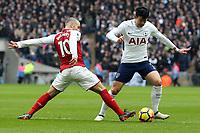 Son Heung-Min of Tottenham Hotspur and Jack Wilshere of Arsenal during Tottenham Hotspur vs Arsenal, Premier League Football at Wembley Stadium on 10th February 2018