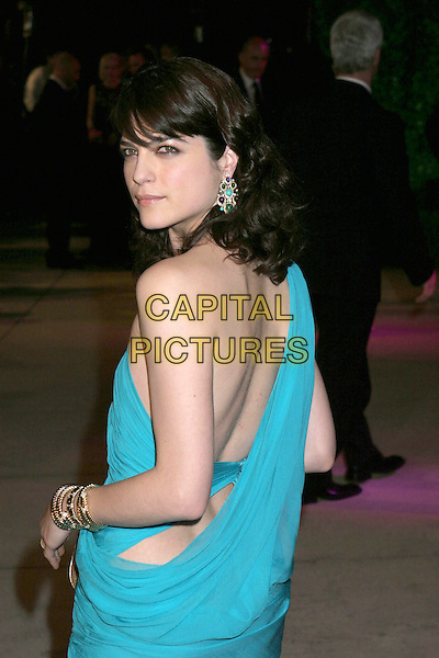 SELMA BLAIR.2005 Vanity Fair Oscar Party held at Morton's Restaurant. West Hollywood, CA.February 27th, 2005.Photo Credit: Jacqui Wong/AdMedia.half length blue turquoise dress one shoulder earrings looking over shoulder back.www.capitalpictures.com.sales@capitalpictures.com.© Capital Pictures.