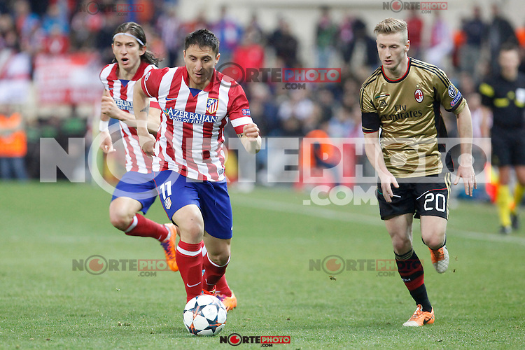 Atletico de Madrid´s Filipe Luis (L) and Cristian Rodriguez and Milan´s Ignazio Abate during 16th Champions League soccer match at Vicente Calderon stadium in Madrid, Spain. March 11, 2014. (ALTERPHOTOS/Victor Blanco)
