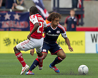 Portland Timbers midfielder Diego Chara (21) trips up New England Revolution defender Kevin Alston (30). In a Major League Soccer (MLS) match, the New England Revolution defeated Portland Timbers, 1-0, at Gillette Stadium on March 24, 2012