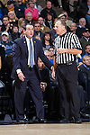 Duke Blue Devils head coach Mike Krzyzewski discusses a call with official Terry Wymer during first half action against the Wake Forest Demon Deacons at the LJVM Coliseum on January 7, 2015 in Winston-Salem, North Carolina.  The Blue Devils defeated the Demon Deacons 73-65.  (Brian Westerholt/Sports On Film)