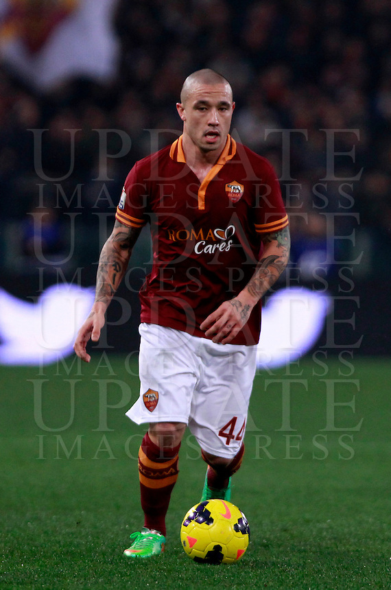 Calcio, quarti di finale di Coppa Italia: Roma vs Juventus. Roma, stadio Olimpico, 21 gennaio 2014.<br /> AS Roma midfielder Radja Nainggolan, of Belgium, in action during the Italian Cup round of eight final football match between AS Roma and Juventus, at Rome's Olympic stadium, 21 January 2014.<br /> UPDATE IMAGES PRESS/Isabella Bonotto