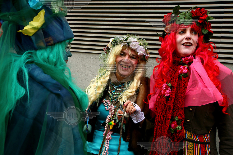 Men in drag get into the carnival spirit on the streets of .Cologne during the city's annual winter carnival.