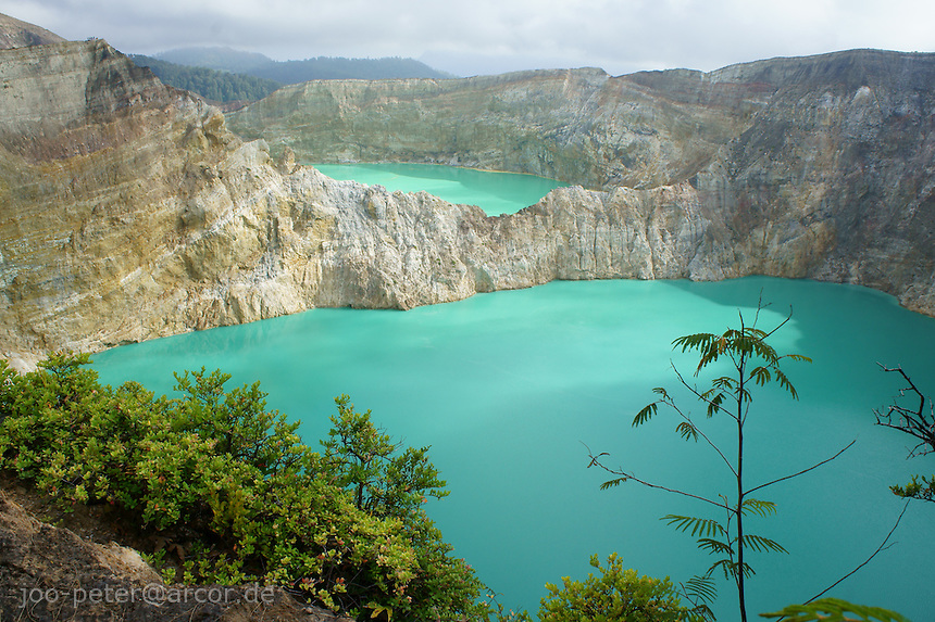 blue and green lake, Tiwu Nua Muri Kooh Tai (lake of boys and girls) and  Tiwu Ata Polo (enchanted lake),vulcano Kelimutu, island  Flores in archipelago of Indonesia.Locals in village Moni believe, the souls of passed village members  go into the lake. Changing colors of the lakes (caused by minerals) would signify, these souls are angry.