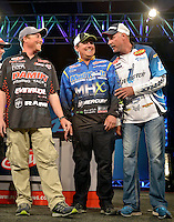 NWA Democrat-Gazette/BEN GOFF -- 04/25/15 Andy Morgan (from right), FLW Pro from Dayton, Tenn., John Cox, FLW pro from Debary, Fla., and Bryan Thrift, FLW pro from Shelby, N.C., share a laugh as the final ten competitors advancing into day four take the stage after weigh-in on day three of the Walmart FLW Tour at Beaver Lake on Saturday Apr. 25, 2015 at the John Q. Hammons Center in Rogers. Morgan maintained his lead with a three-day total weight of 39 lbs. 2 oz.