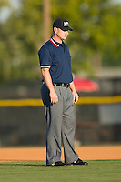 Michael Cafaro umpires the bases in the Appalachian League game between the Princeton Rays and the Burlington Royals at Burlington Athletic Park in Burlington, NC, Monday August 11, 2008. (Photo by Brian Westerholt / Four Seam Images)