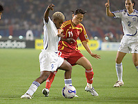 World Stars' Portia Modise battles for the ball against China's Caixia Xie. The FIFA Women's World Stars played an exhibition match against China at the Wuhan Sports Center Stadium as part of the Women's World Cup Draw on April 21, 2007.