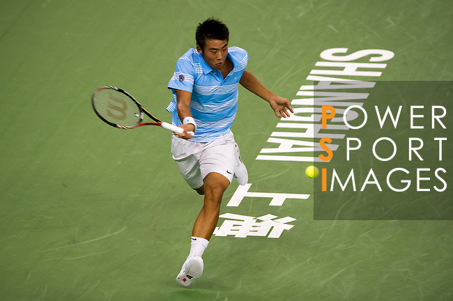 SHANGHAI, CHINA - OCTOBER 12:  Ze Zhang of China returns a ball to Ivan Ljubicic of Croatia during day two of the 2010 Shanghai Rolex Masters at the Shanghai Qi Zhong Tennis Center on October 12, 2010 in Shanghai, China.  (Photo by Victor Fraile/The Power of Sport Images) *** Local Caption *** Ze Zhang