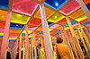 At Art Basel, the annual gathering of the modern and contemporary art worlds, visitors view the work of artist Daniel Buren.  The fair features the work of more than 1500 artists, from every continent, and is an important nexis of dealers, collectors, and artists worldwide. Photo by Kevin J. Miyazaki/Redux 2005
