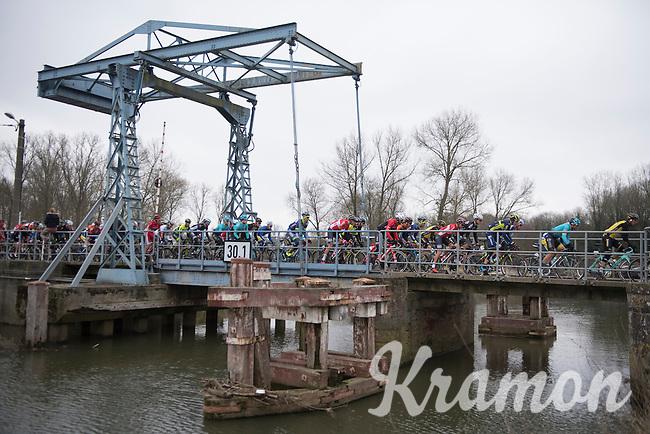 Peloton on the old industrial Zandbergen bridge over the Dender river<br /> <br /> 69th Kuurne-Brussel-Kuurne 2017 (1.HC)